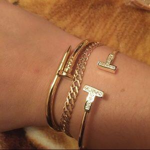 T gold designer bracelet